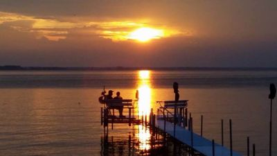 Photo for Green Bay waterfront chalet with boat launch - Best sunsets on the bay!