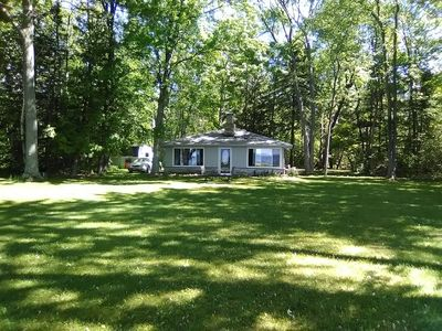 Photo for Cozy lakefront  cottage on a beautiful, private and SPACIOUS park like setting!
