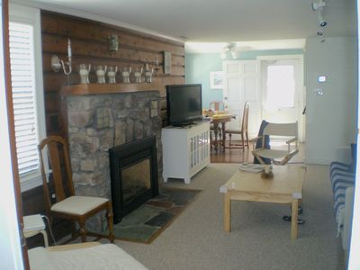 First floor family room with stone hearth and gas fireplace.