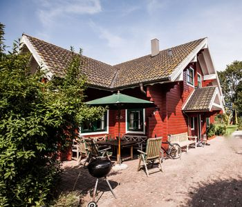 Photo for Family vacation in the cozy Sweden style house with spacious garden, WLAN