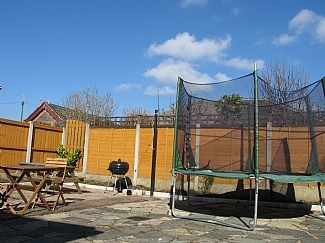 Large outside rear patio with bbq note there is no trampoline