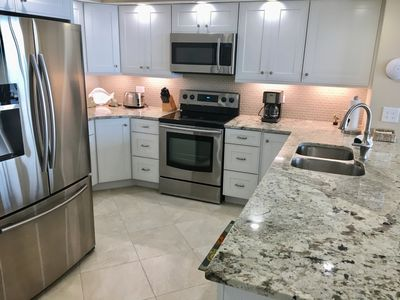 The custom kitchen is fully equipped and features an exotic granite countertop.