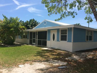 Photo for Quaint cottage, pool, dockage just minutes to Key West!