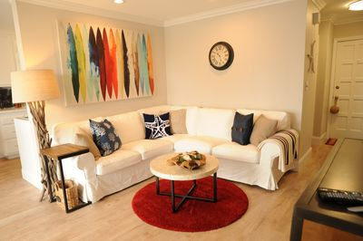 slip covered couches and tasteful nautical decor