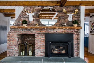 Living room fireplace accompanied by tasteful decor