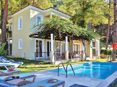Photo for Nestled on a hillside offering pretty mountain and sea views, villa Mert is conveniently located within a 5 minute drive of the popular resort of Gocek and the fabulous selection of shops, bars and restaurants it has to offer