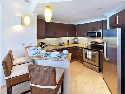 Photo for Modern Beachfront Condo with Pool - Sapphire Beach 317