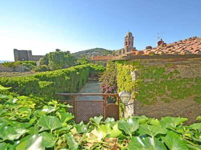 Photo for Ancient restored villa with a large courtyard in the heart of the village