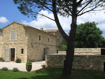 Photo for Menerbes old stone wine cellar with secure swimming pool & enclosed garden