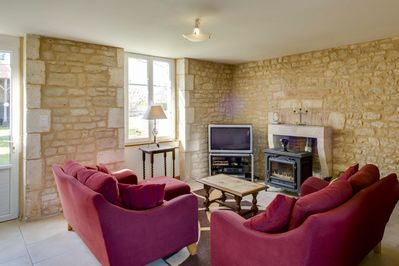 Living area with woodburner. Tv with UK/French free-to-view channels. Free wifi.