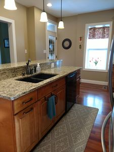 Sink, dishwasher, and 5 bar stools in the kitchen island