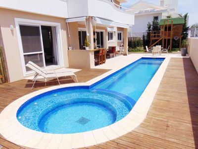 Photo for Luxury house in Jurerê Internacional with 4 Suites pool and garage for 6 cars.