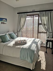 Bed with full sun for B&B guest with water provided.