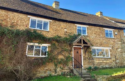 Photo for Bridge Hill Cottage - a picture-postcard Cotswold-stone house, in the village of Hook Norton