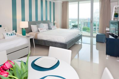 Bedroom with beds for four, ample dining area, plenty of light. Clean, no carpet