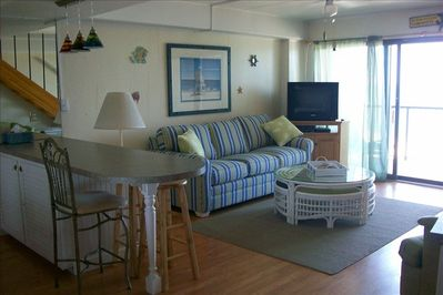 Welcome to your beach home away from home!  The den leads out to the first floor beachfront balcony with a perfect view of the ocean!