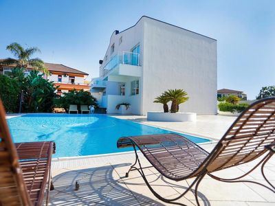Photo for Etna Apartment - Modern and Comfortable Eco-Apartment with Communal Swimming Pool and Garden ! FREE WiFi