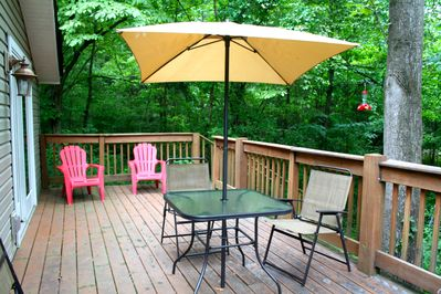 An attached deck allows for a beautiful viewing of the nature surrounding you.