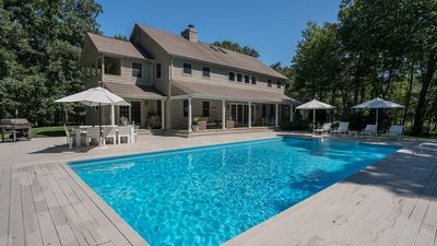 Photo for New Listing: Tucked Away Sag Harbor Home on 3 Wooded Acres w/ Heated Pool, Stunning Interiors