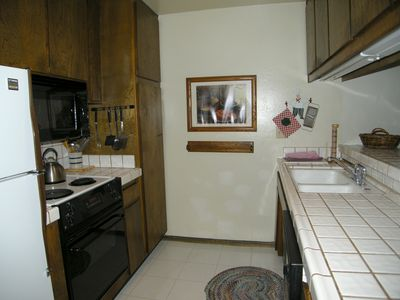 Kitchen with tile countertops