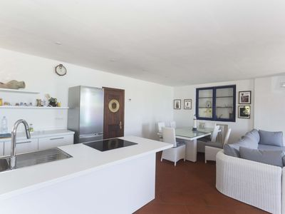 Photo for Porto Azzurro - Modern and bright apartment overlooking the seafront