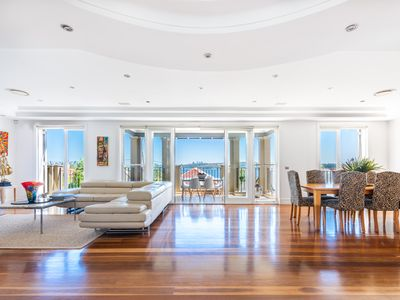 Photo for Stunning harbour views in prestige Sydney location with balcony and pool
