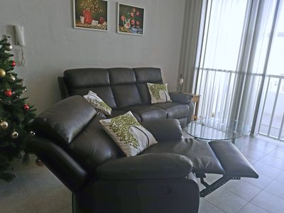 Comfortable fully reclining sofas in the living area