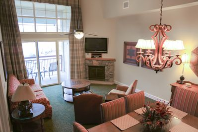 Living/Dining Room Combination With Flat Screen TV, Fireplace & Balcony Access