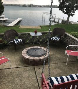 stone fire pit on the lower deck overlooking the lake