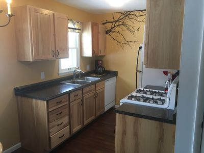 Hickory Kitchen, sunny view to the back yard; Roomy meal prep area.