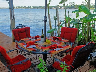 Welcome to a tranquil vacation on the lake! Enjoy dinner or drinks lakeside.