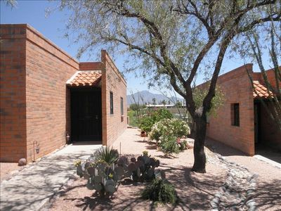 Front of Casita with mountains in background!! and side access to back patio!!