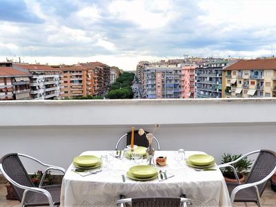 Photo for Bright penthouse with view over Rome, Wifi, A / C, metro station 1 minute away