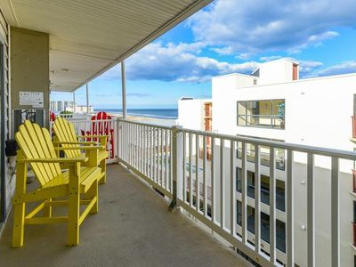 Photo for NEW! Updated, cute & cozy ocean view condo just steps from the beach!