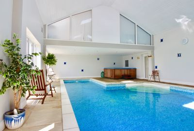 Private heated indoor swimming pool with hot tub