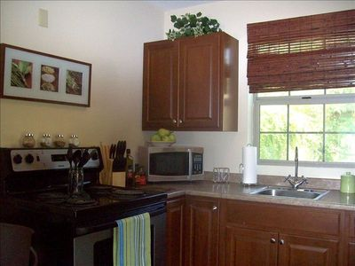 Microwave, oven-range, refrigerator, all dishes, pots & pans, coffee maker.