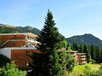 Photo for Cozy apartment with a balcony located in Chamrousse