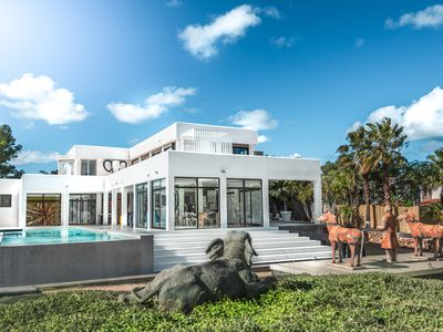 Photo for 8 bedroom luxury villa with twin sea views in walking distance to beach