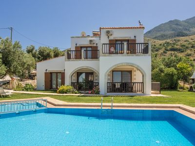 Photo for Located on a slope, the villa offers magnificent view over the lake and the sea