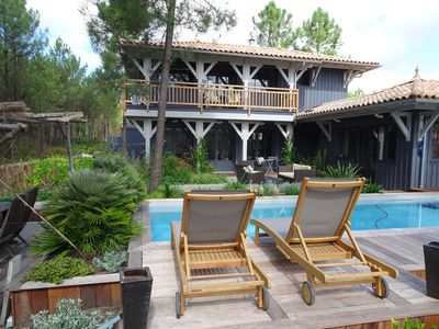 Photo for Superb wooden villa, heated pool, spa, all comfort, between ocean and pool