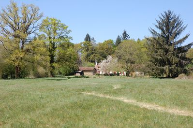 looking back at the farmhouse from our southern meadows