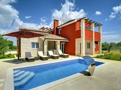 Photo for Stunning private villa with hot tub, private pool, WIFI, A/C, TV, pets allowed and parking
