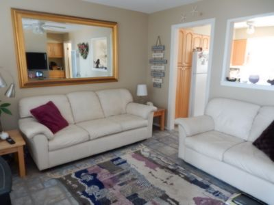 Leather sofa and love seat, in fully decorated living room