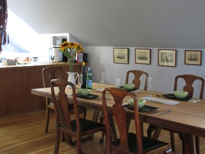 Dining table seats 10.  Table was fashioned from a salvaged bowling alley lane.