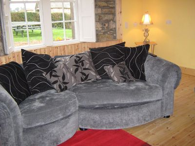 relax by the open fire on cosy sofas