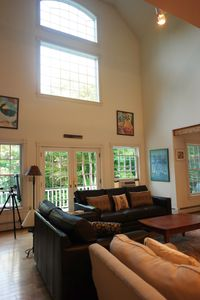 Soaring family room with tons of natural light! Leather couches.