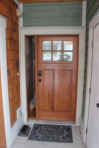 Front door with ski locker on the right