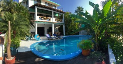 Private oasis. View from the palapa of the beautiful pool and patio area.