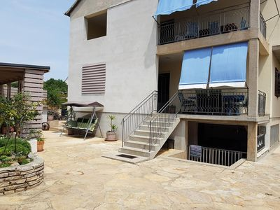 Photo for Four bedroom apartment with terrace Pakoštane, Biograd (A-18020-a)