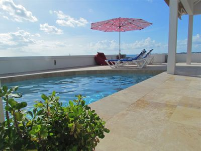 relax on the spacious pool deck with the ocean right below. stunning 280* views